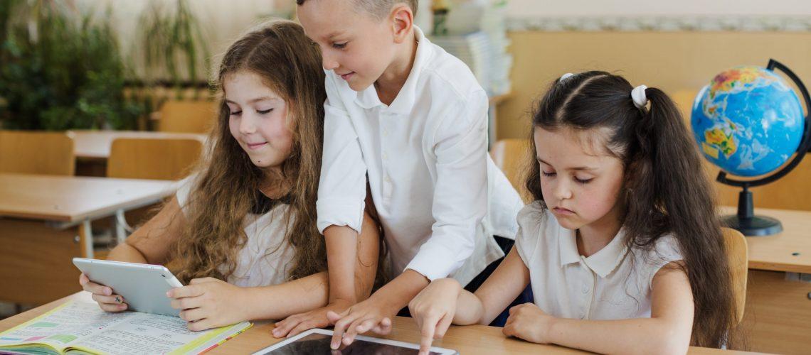 schoolchildren-using-tablets-classroom
